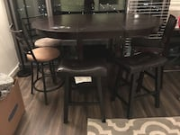 Oval black wooden dining table & 5 counter height chairs Reston, 20190