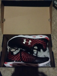 Pair of red-black-and-white Under Armour sneakers in box size 12 men's