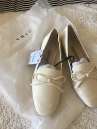 pair of white leather loafers New York, 11694