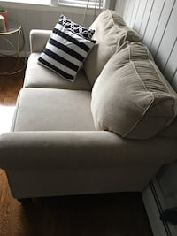 Ashley love seat Whether you're creating a warm and cozy modern farmhouse or cool and contemporary escape, the Ashley loveseat is sure to look right at home. High armrests with a rounded track design provide a chic, sheltering effect. Light linen-tone uph Pelham, 10803
