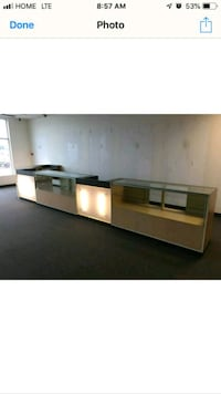 brown wooden counter and display 551 km