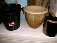 Two planter pots and a bucket