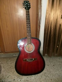 red and black acoustic guitar 12862 km