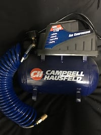 Blue and black campbell hausfeld air compressor