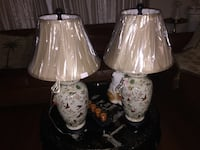 two white-and-pink floral ceramic table lamps