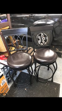 Three black leather padded bar stools or Best offer Chair from seat to floor is 24 inches from chair backrest to floor is 40 inches. Toronto, M6N 2G2
