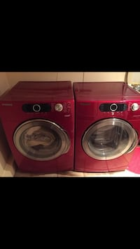 Red samsung front-load clothes washer and dryer