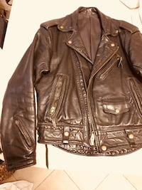 Real 1950s Langley Leather motorcycle jacket. In perfect condition. It was purchased at an auction in a frame once owned by Keith Richards from the Rolling Stones. Rancho Palos Verdes