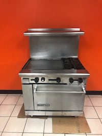 Gray and black gas range oven