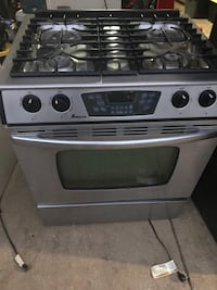 Amana Slide in Gas Range and LG Over the Range Microwave.