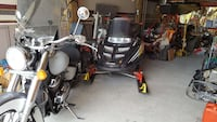 black snow mobile; white and black touring motorcycle