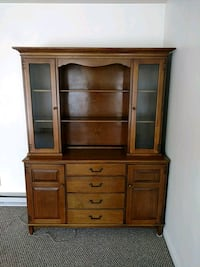 brown wooden cabinet with drawer