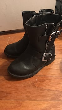 pair of toddler's black biker boots