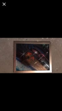 solar system painting with gray frame