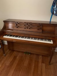 Brown wooden upright piano with chair Hyattsville, 20783