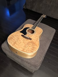 brown and black acoustic guitar Toronto, M9C