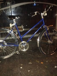blue and black road bike Surrey