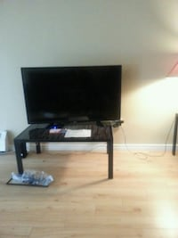 flat screen television with TV stand Maple Ridge, V2X 5A5