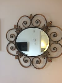 Black and white metal framed wall mirror