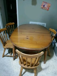 round brown wooden table with 4 chairs dining s Largo