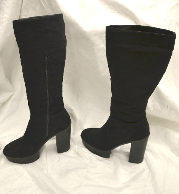 Almost new tall black suede platform boots, very light weight. Size 9, but feels a little like 8.5