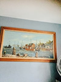 brown boat and houses beside the beach painting