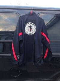 black and red mans jacket large