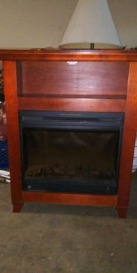 brown wooden framed electric fireplace Riverside, 92507