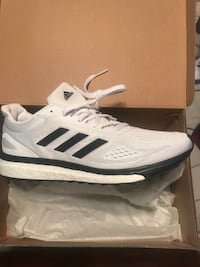 pair of white-and-black Adidas sneakers Greenville, 29607