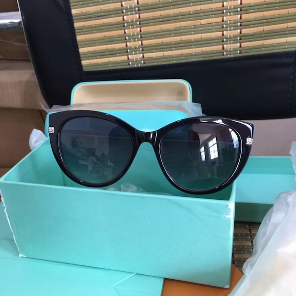 black framed sunglasses with box