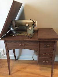 Sewing machine and table