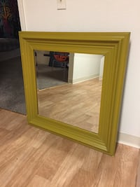 Big yellow mirror with hanging wire