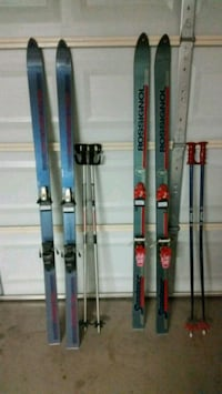two pairs of blue and green snow skis with ski sticks Gilbert, 85233