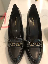 pair of black leather flats Toronto, M4E 2N1