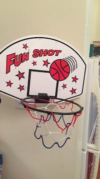 toddler's white and red Fun Shot basketball hoop and backboard