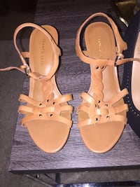 women's pair of brown leather open-toe ankle strap heels