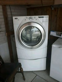 white front-load clothes washer North York, M3H