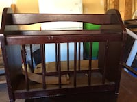brown wooden crib with changing table Calgary