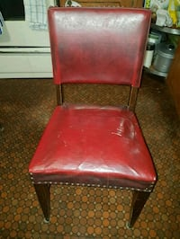 brown leather padded chair with brown wooden base 543 km