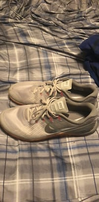pair of gray Nike running shoes Inola, 74036