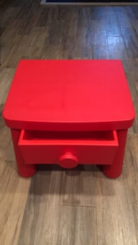 Red plastic kids table with drawer
