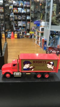 red and gray Hershey's Chocolate truck scale model