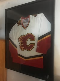 Autographed and framed flames jersey