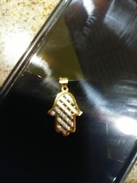 gold-colored Diamond hamsa pendant