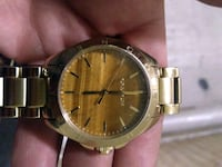 round gold-colored analog watch with link bracelet Vancouver, V6Z 1W1