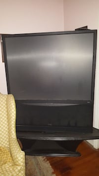Big Screen TV and Bar stool w/4 chairs.