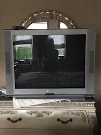 gray CRT TV with black wooden TV stand Vaughan, L4H 1W2