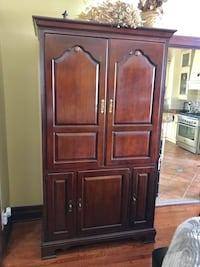 Brown wooden cabinet with drawers from Lexington retailed $3500