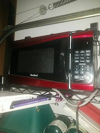 black and red Westbend microwave oven