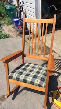 Black and gray plaid cushioned wooden rocking armchair